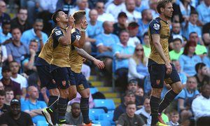 Alexis Sánchez celebrates scoring Arsenal's second equalise against Manchester City