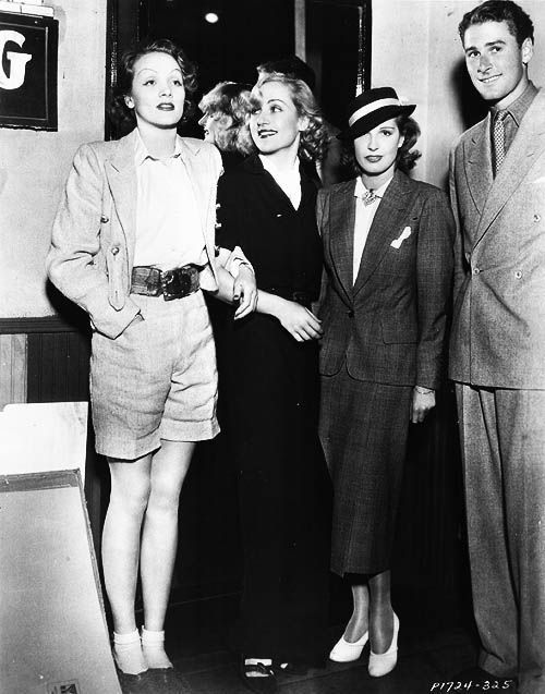 Marlene Dietrich, Carole Lombard, Lili Damita and husband Errol Flynn.at Carole Lombard's party at the Venice Fun House, circa mid-1930s.