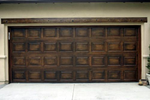 Faux wood painting for garage door in the 949 looks like for Faux wood front doors