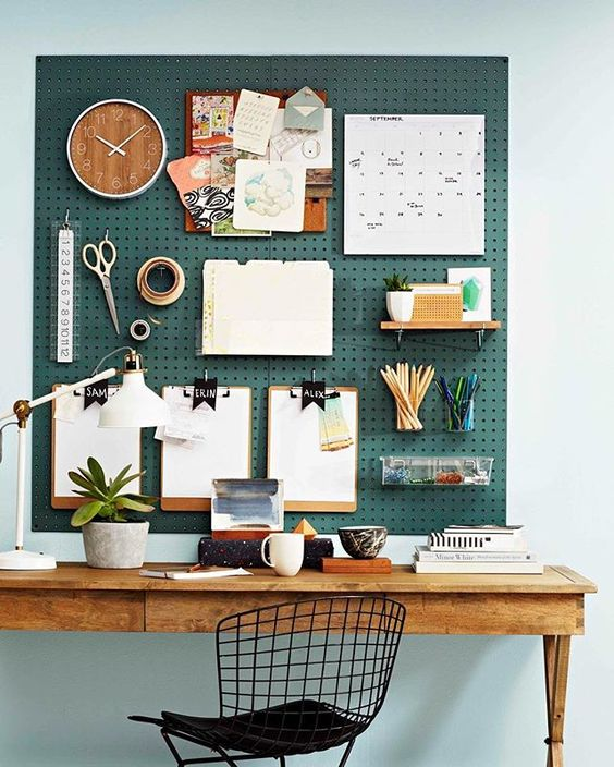 Get hooked on this over-the-desk pegboard organiser! All you need is a sheet of masonite pegboard, various hooks, a table, chair and desk lamp and you're in business — the home office kind! Style up your pegboard organiser with colour (if you like this shade, try Dulux Inner Space) and accessories such as acrylic or wire baskets, mini shelves and pen holders. For more great pegboard and storage ideas, check out the February issue of Better Homes and Gardens magazine. Dora, deputy and decorat...