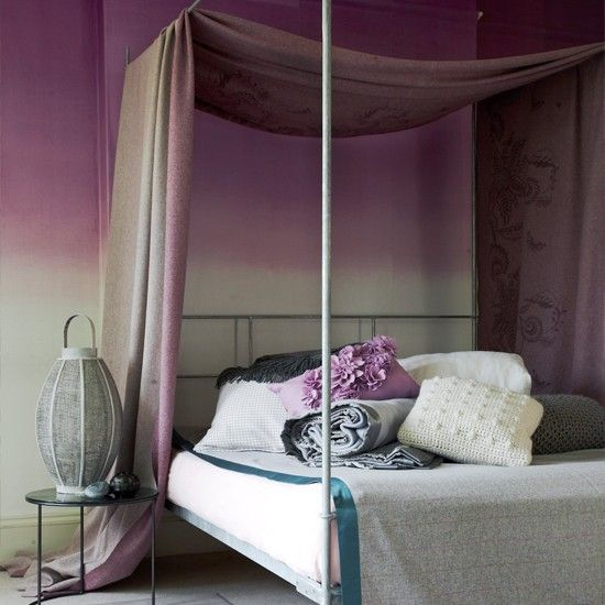 Purple bedroom with draped fabric: