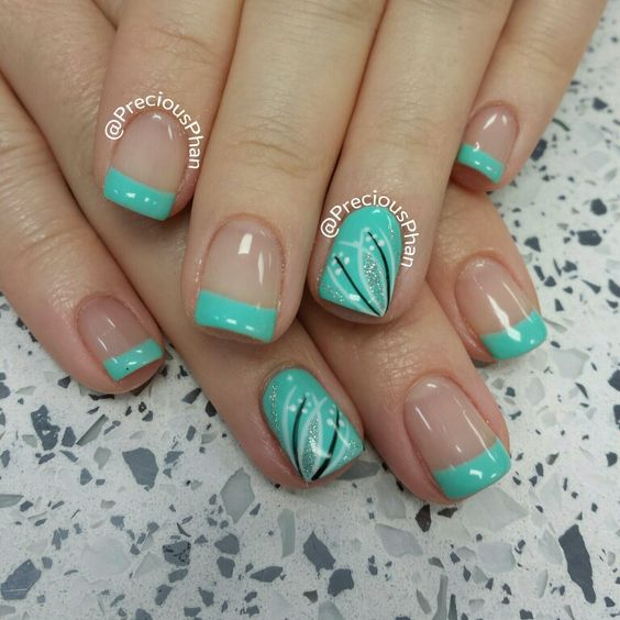 Mint french nails with a nail art design