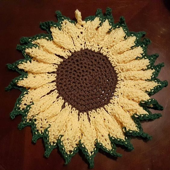 Crocheted sunflower potholder I did today is finished.. by dawnyallen18