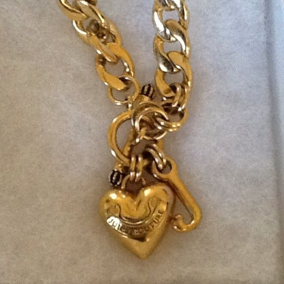 Juicy Couture necklace gold tone In excellent condition. Toggle necklace with puffy heart and signature J. Firm on this price Juicy Couture Jewelry Necklaces