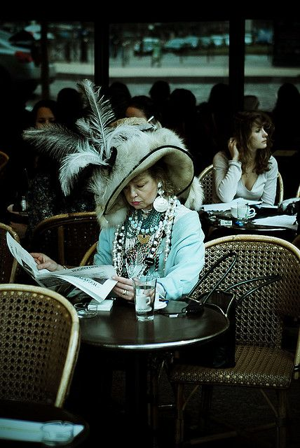 When I grow up - I want to be this lady, sitting at a café in Paris, alone, drinking coffee with weird clothes on.:
