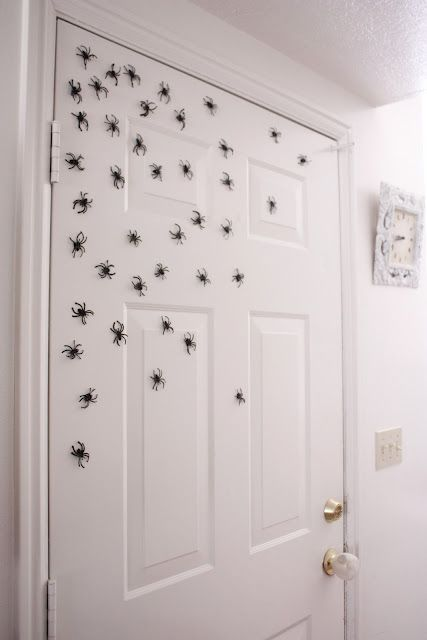 Just glue magnets to the backs of plastic spiders and put on your front door!  So cool!