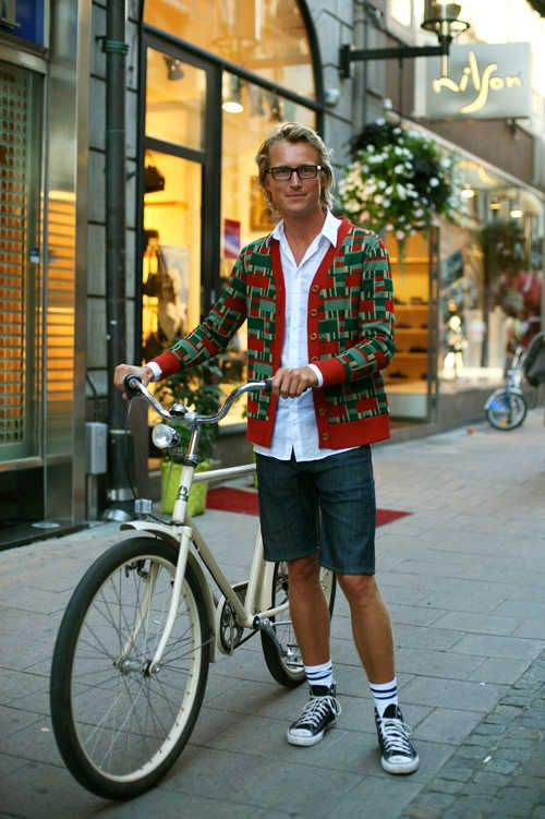 a quirky approach by man in vintage cardigan...