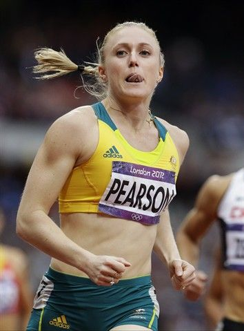 Australia's Sally Pearson competes in a women's 100-meter hurdles semifinal during the athletics in the Olympic Stadium.