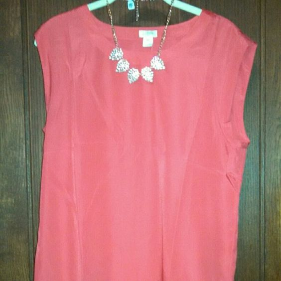 Red drapey sleeveless blouse Vibrant true red sleeveless poly shell.  Slight cap sleeve with rounded neckline and hemline. Color is is more of a true bright red in natural light (see pic 2). 100% polyester. From J Crew Factory. J. Crew Tops Blouses