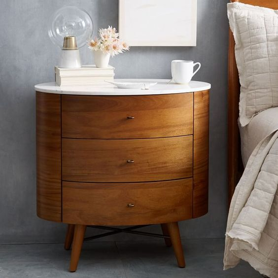 What usually comes in a pair and has the placebo effect of making us feel all grown up? A couple of well-appointed nightstands. Don't believe us? Try it for yourself—shop our favorites below.: