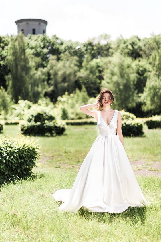 Fluffy draped satin corset wedding dress with long train by CathyTelle on Etsy https://www.etsy.com/listing/463131828/fluffy-draped-satin-corset-wedding-dress