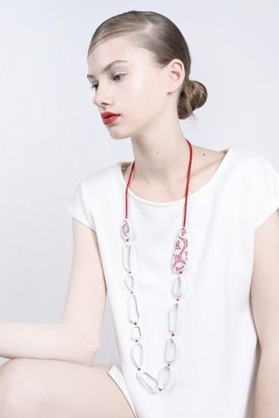 Yafit Ben Meshulam - Kotaro necklace - Ten ceramic links and tow ceramic pieces with red embroidery engraving and Coral beads.  * Materials /   Ceramic, Coral  * Chain length 28 inch, no bracket  * Finish / Matte ceramic, shiny red resin