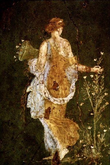 Flora, Diosa de la primavera (Roma, Siglo I). Arte Romano. // Fresco de la Villa Arianna. Una figura femenina, pintada sobre un fondo verde agua, camina descalza y vestida con una túnica amarilla, movida por la brisa, mostrando un hombro desnudo. En su movimiento hacia lo desconocido, recoge flores. Estilísticamente pertenece al tercer estilo pompeyano con vagas reminiscencias helenísticas.: