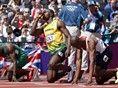 Jamaica's Usain Bolt, Britain's James Dasaolu, right, and Nigeria's Ogho-Oghene Egwero line up on the start blocks.