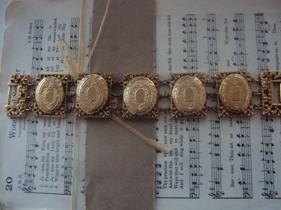Hey, I found this really awesome Etsy listing at http://www.etsy.com/listing/150320579/vintage-locket-bracelet-signed-by-art