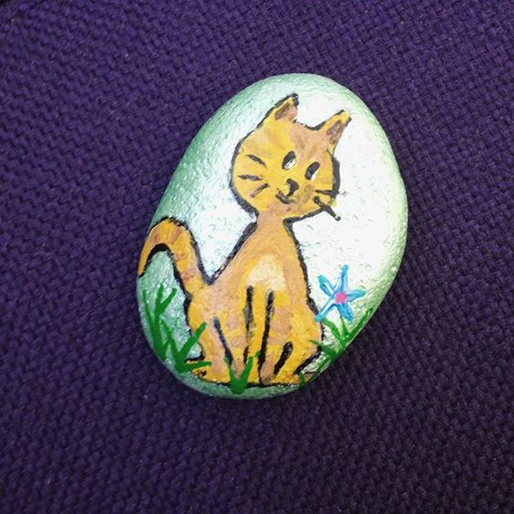 This #cat rock was left in #sacramento #springtime #spreadartproject #meow #art #painting #green #outside