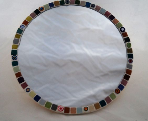A personal favourite from my Etsy shop https://www.etsy.com/uk/listing/262338087/round-mini-mosaic-tiled-mirror
