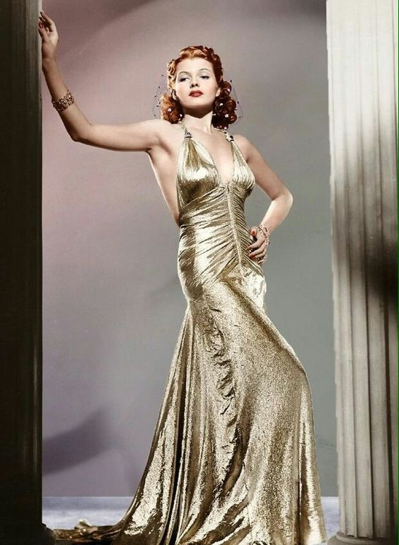 Grey days need Rita Hayworth in a gold lamé gown.