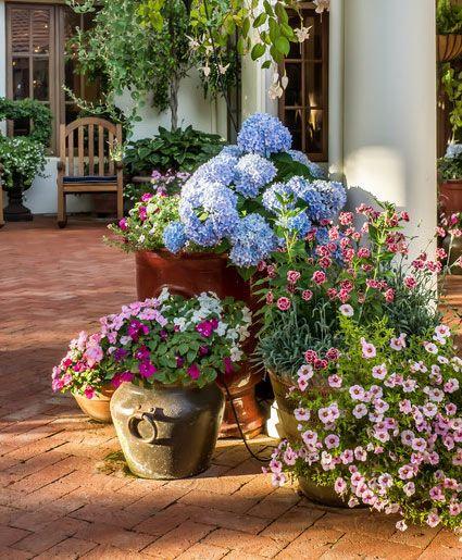 Artificial flowers in patio pots