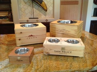 Handmade Elevated Dog Feeders crafted from reclaimed wooden wine crates and cigar boxes.