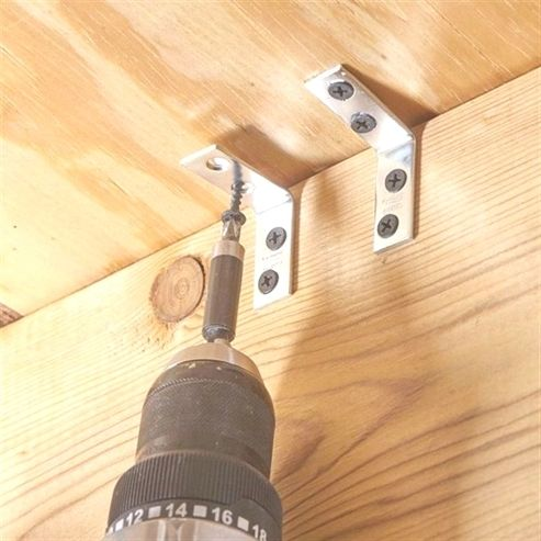 Here S A Simple Fix For Squeaking Floor Joists Screw A 1 1 2 In Corner Bracket To The Joist About Squeaky Floors Diy Home Improvement Fix Squeaky Floors