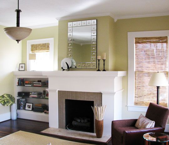 I've always hated my fireplace area - I think this year, I will tear down the pillars and put bookshelves on either side with new windows. And this green is amazing!