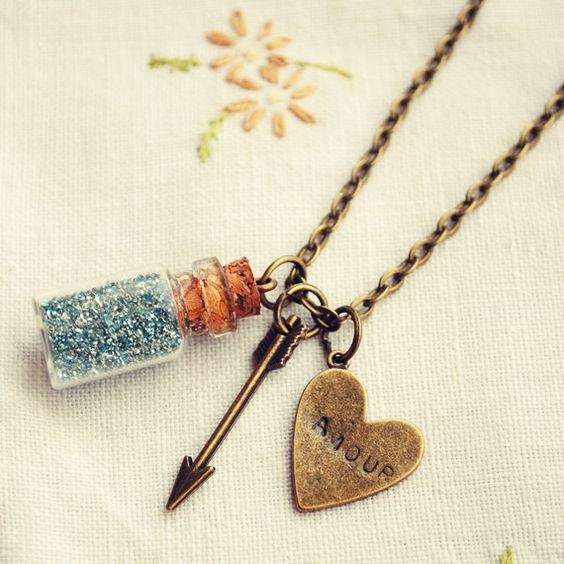 Little Bottle Necklace with Blue Glitter, Arrow and Heart via Etsy: