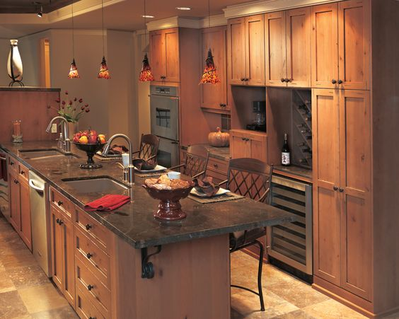 Alderwood kitchen cabinets with a light stain millennia for Canyon creek kitchen cabinets