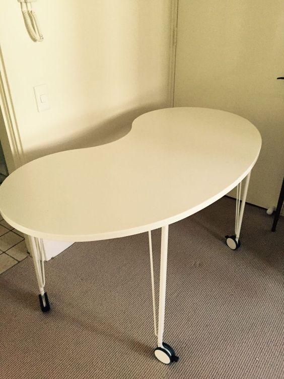 KIDNEY SHAPED TABLE OR OFFICE DESK with wheels also.