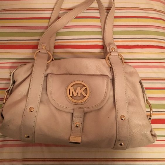 Michael Kors cream bag Michael Kors bag. Shoulder straps. Interior in great shape. Some wear on exterior. Can use leather cleaner to get out marks. Michael Kors Bags Shoulder Bags