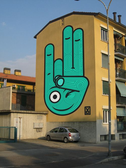A smiling, winking hand! By Italy's Visually Odd (http://globalstreetart.com/visuallyodd). Can't disagree with the name!