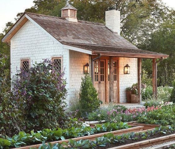 Garden shed from episode of Fixer Upper where Chip and Joanna build and design a new garden shed, garden and chicken coop for their own farm? The inspiration for the she shed is the huge diamond-paned window that she has been storing in her massive warehouse filled with amazing flea market finds. #gardenshed #fleamarketgardening #sheddesigns #sheshed