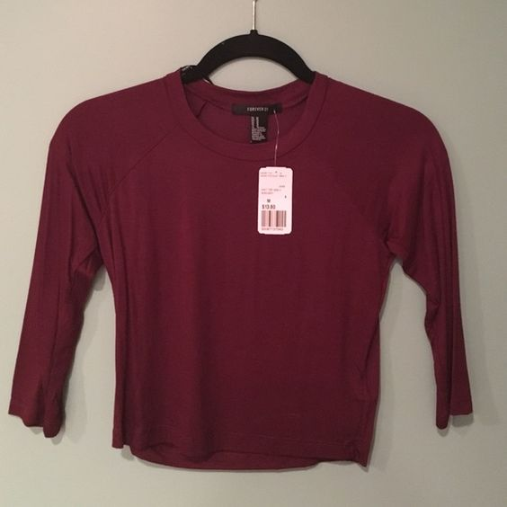 Maroon crop top from forever 21 This is a maroon crop top with quarter length sleeves. Fits tightly but is very soft and stretchy Forever 21 Tops Crop Tops