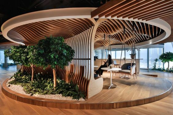 The Future of Workspaces. Natural materials, fresh air and lots of plants are used to create this biophilic workspace.