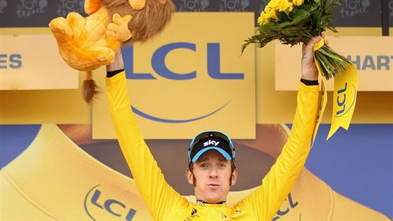 Team Sky's Bradley Wiggins officially became the first British rider to win the Tour de France on Sunday. (via AP; photo via Bryn Lennon / Getty Images)