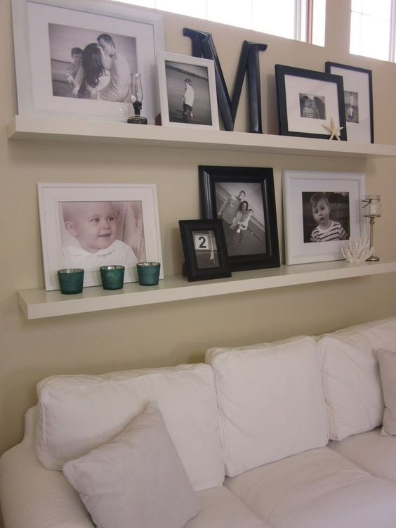 ideas of how to display family photos on a simple shelf above your couches in the living room. Black Bedroom Furniture Sets. Home Design Ideas