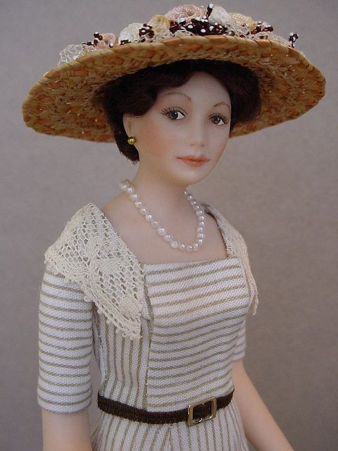 Inspired by Lady Mary Crawley from Downton Abbey, this 5 inch high porcelain dollshouse doll was created by Debbie Dixon-Paver