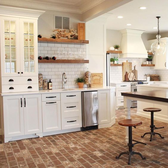 Really like the look of the brick with white cabinets.