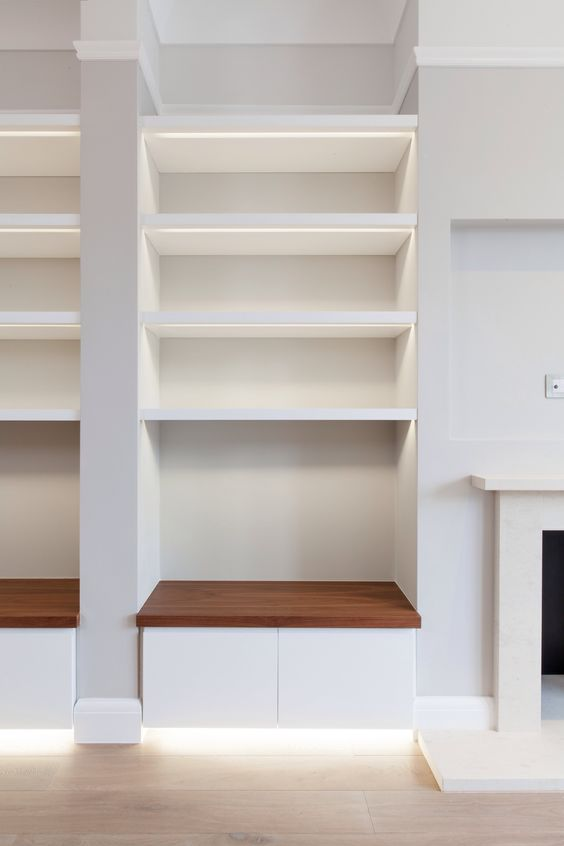Storage to fireplace recess. LED detailing