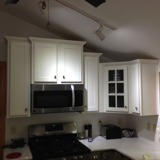 Legacy Cabinetry   Ivory Paint   Cambria/Quartz Top