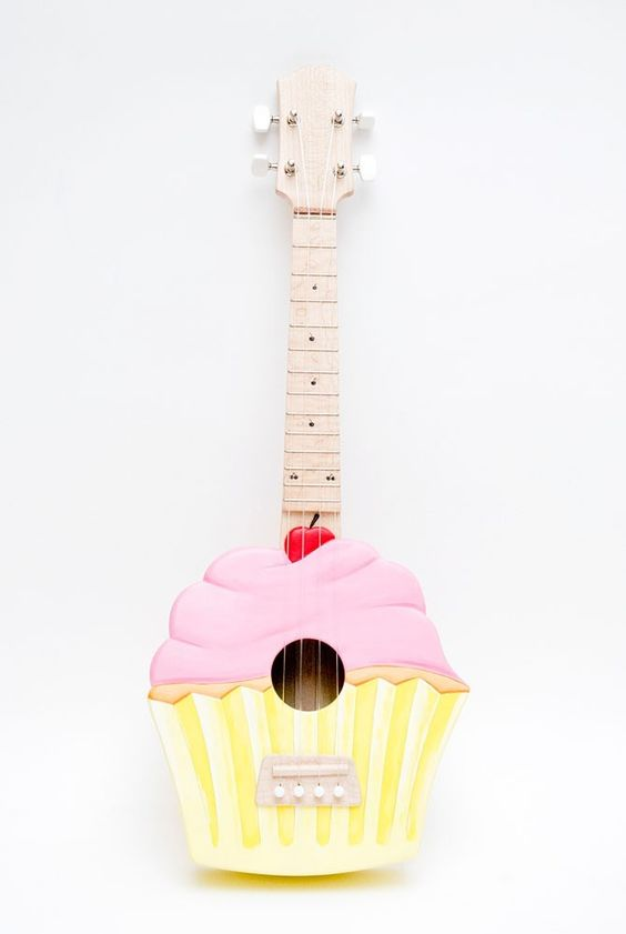 I'd say this is elegant for a Cupcake ukulele!   $450.00 USD, via Etsy.