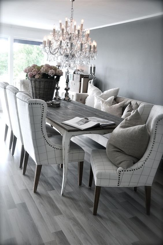 Grey rustic dining table with beautiful fabric chairs the for Beautiful dining furniture