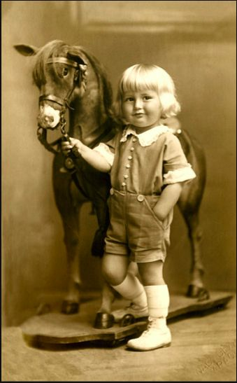 I have no idea when this photo was taken but the child and outfit are adorable!:
