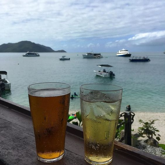 A cold one on #Fitzroy #island after @eissem and I climbed the summit #beach #mountain #fitzroyisland #queensland #visitqueensland #australia #cairns #summit #hike #beer #cider #bar #view #travel #tropics #schooner #greatbarrierreef by talelm http://ift.tt/1UokkV2