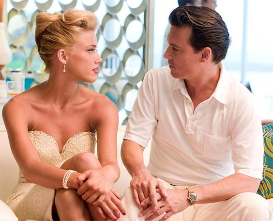 Is Amber Heard's Relationship With Johnny Depp a Business Arrangement?
