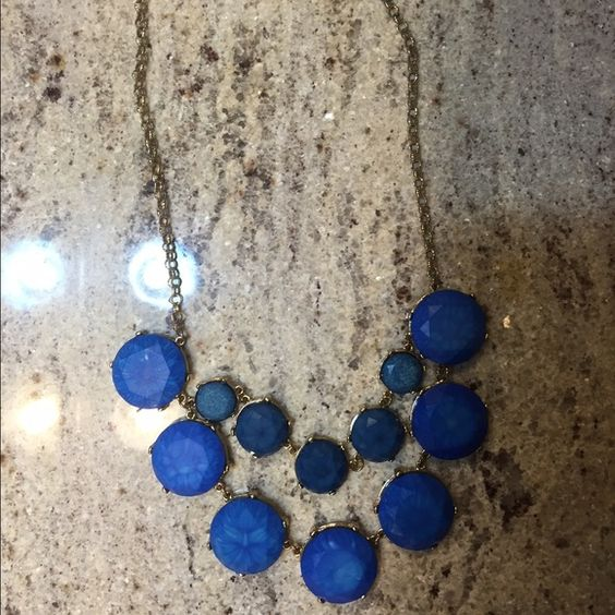 Sapphire Blue Statement Necklace This necklace has stunning sapphire blue stones around an adjustable gold chain. It has one small gold piece that sticks out a little but you barely notice it. It is shown in the third picture. I got it repaired at a jewelry store. This lovely necklace was purchased from Francesca's!! Francesca's Collections Jewelry Necklaces