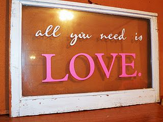 'all you need is LOVE.' on an old window