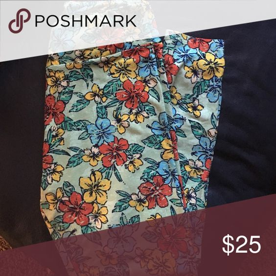 LulaRoe Green Hawaiian floral TC Worn once and washed once. Very pretty pattern, but I need to de-LulaRoe some (never thought I would say that). The Flowers are red, blue, and yellow/gold. Made in Vietnam. LuLaRoe Pants Leggings