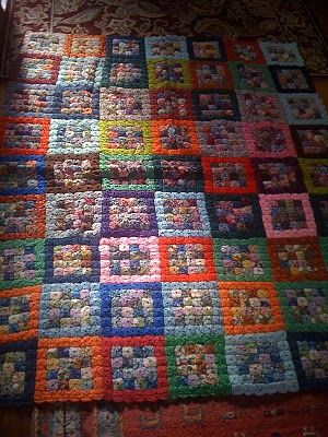 Take a look at Jamie's antique yo yo quilt...love it...