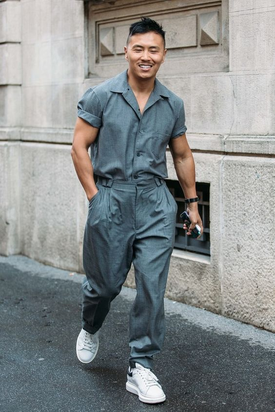 A stylish and daring young gentleman wearing a full overalls jumpsuit in Milan…